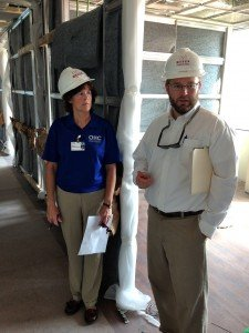 Alexander Green and Cathy King keep a close watch on OHC West's building details.