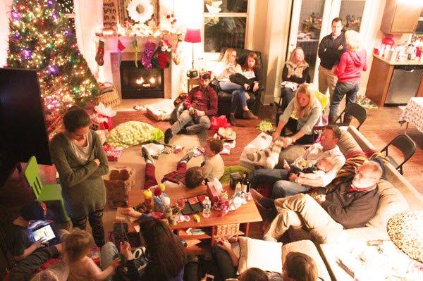Family Gathered around Christmas Tree
