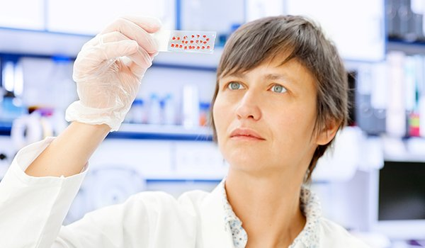 Woman examining blood samples