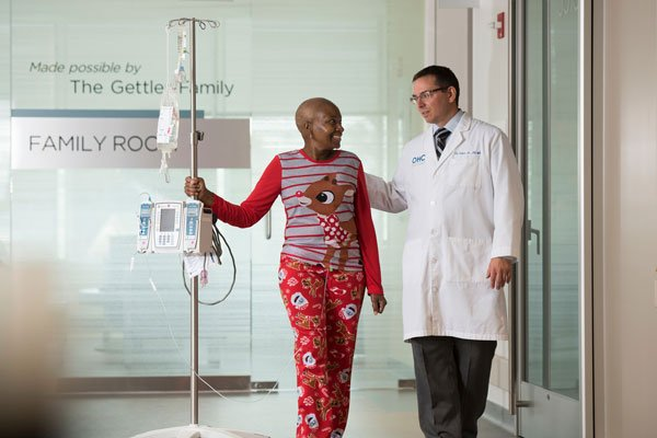 Dr-Edward-A-Faber-Jr-with-Female-Black-Cancer-Patient-Walking-Down-Hall-OHC-Cincinnati